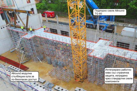 Модулно скеле Allround при строежа на ново училище – комбинация от работно и подпорно скеле TG 60 със стълбищни кули от Layher